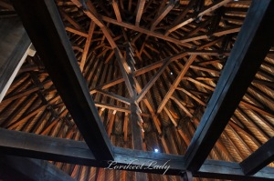 The timber supports of the cone shaped roof on the Tour