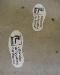 Follow these footprints through the carpark and across the pedestrian bridge.