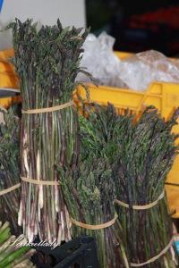 Tempting bundles of asparagus in an Italian market.